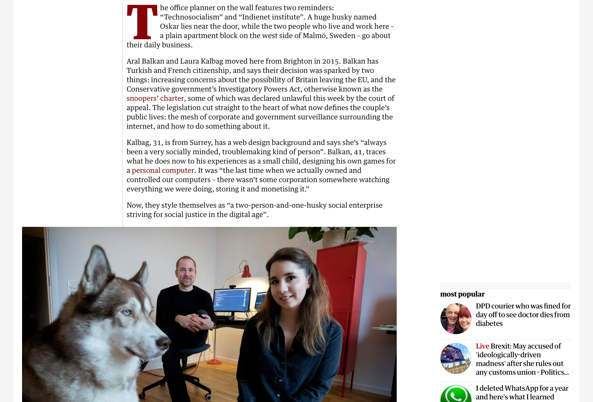 Screenshot of the beginning of the Guardian article featuring a photo of me, Aral and Oskar our dog in our office. Oskar is on the left looking into the distance. Aral and I are not posing.