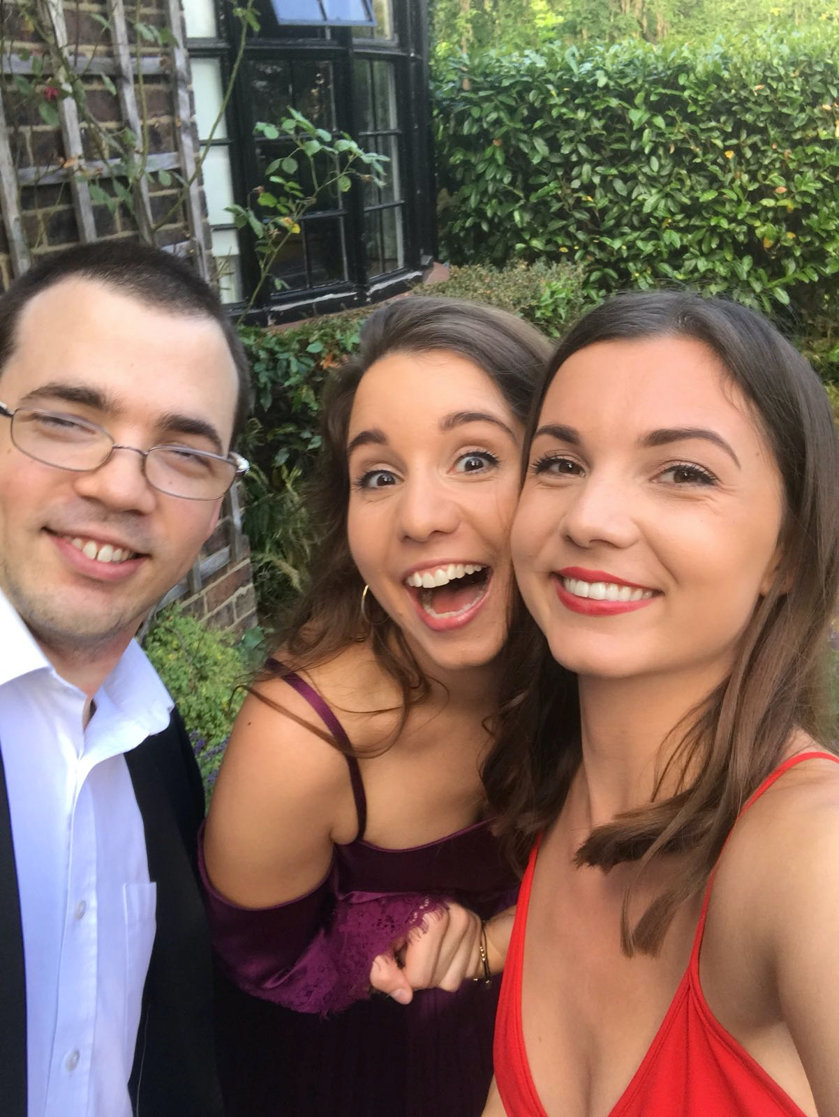 Me, my sister Jess and my brother Sam, dressed smartly and smiling for the camera in a slightly goofy way.