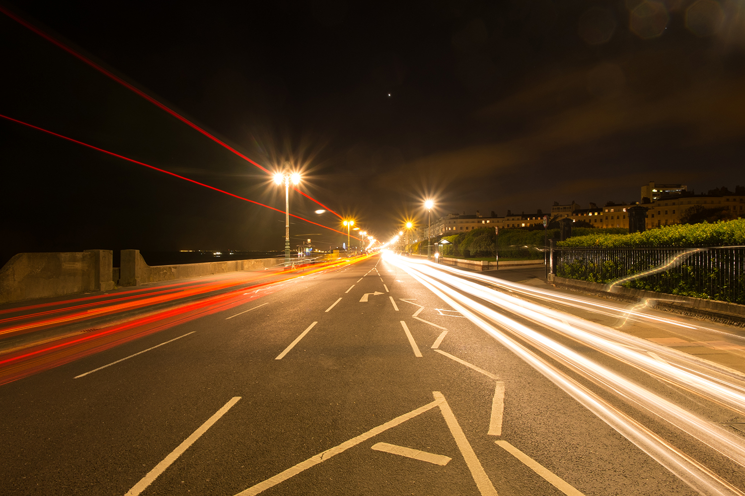 Streaks of light on a road caused by traffic  during a long exposure.